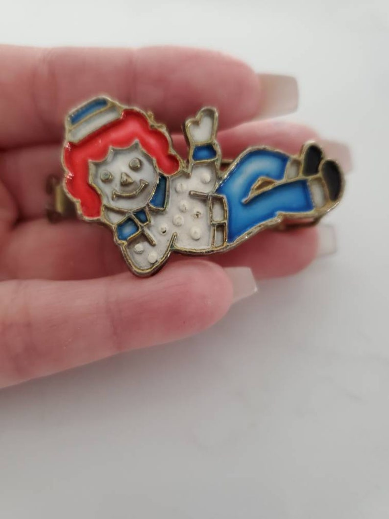 Vintage 1970/' Mamasell Raggedy Ann and Andy hair pin of Andy.