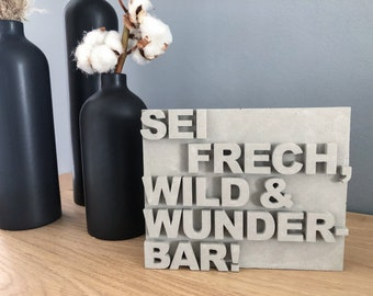 """Concrete sign """"Be naughty, wild and wonderful!"""" 