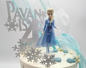Frozen snowflake themed cake topper package with six additional snowflakes