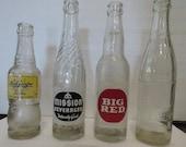 Vintage soda bottles NuGrape, Woosie, Mission and Big Red