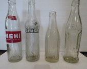 Group of 4 vintage soda bottles Sanitarr, NeHi, Crush, and Kaki Cola (Coca Cola - Saudi bottling)
