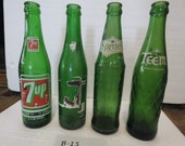 Group of four vintage, collectible soda bottles