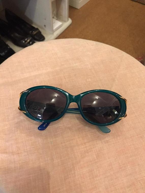 Jean Patou blue glasses