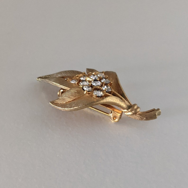 Vintage JJ Brooch Leaves  Brushed Goldtone and Clear Colored Crystals