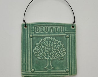Growth Pottery Wall Hanging Green Tile With Craftsman Style Tree of Life Motif