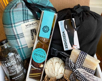 Winter Women's Spa Package. Bath and Body. Flannel Pajama Pants. Warm Black Top. Gourmet Chocolate. Handcrafted Soap. Charcoal Scrub.