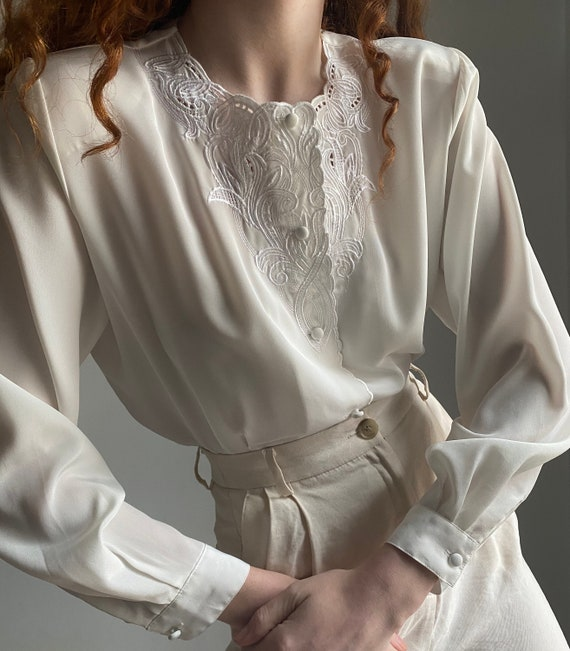 vintage white blouse with embroidered details