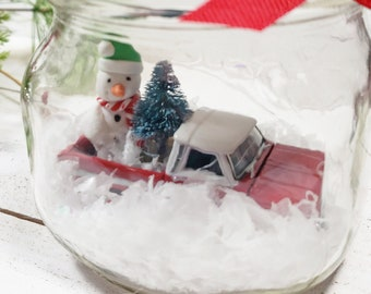 Mason Jar water less snow globe with vintage red 1960s Chevrolet pick up truck toy car model, snowman, tree. Chevy classic car gift for men
