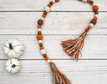 """26"""" Wooden Bead Garland with Yarn Tassels for Shelf Fall Decor or Autumn Tiered Tray Decorations, Latte Brown, Ivory & Spiced Orange Mantle"""