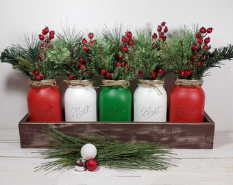 Set of 5 quart white, red & green painted Mason jars w wooden planter box w holiday greens for Farmhouse Christmas dining table centerpiece