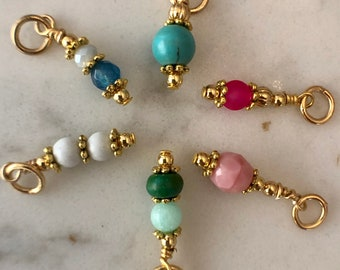 Interchangeable gold charms to hang on huggie and hoop earrings to add that pop of colour