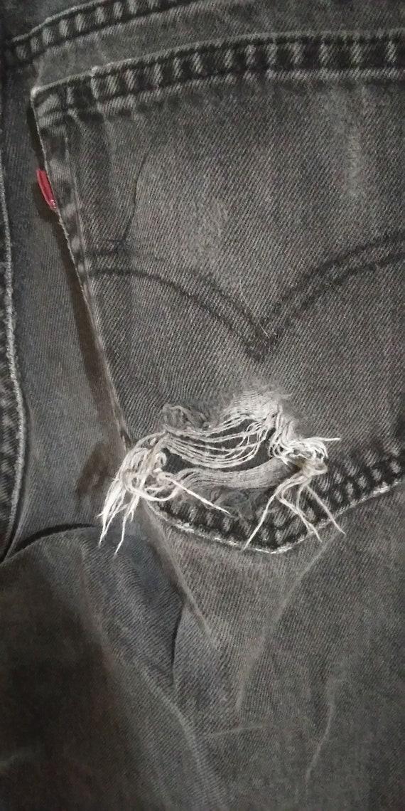 Vintage 1990s Black Levi's Jeans.