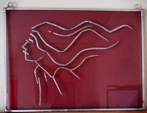 Line Drawing of Woman's Profile in Solder on Stained Glass