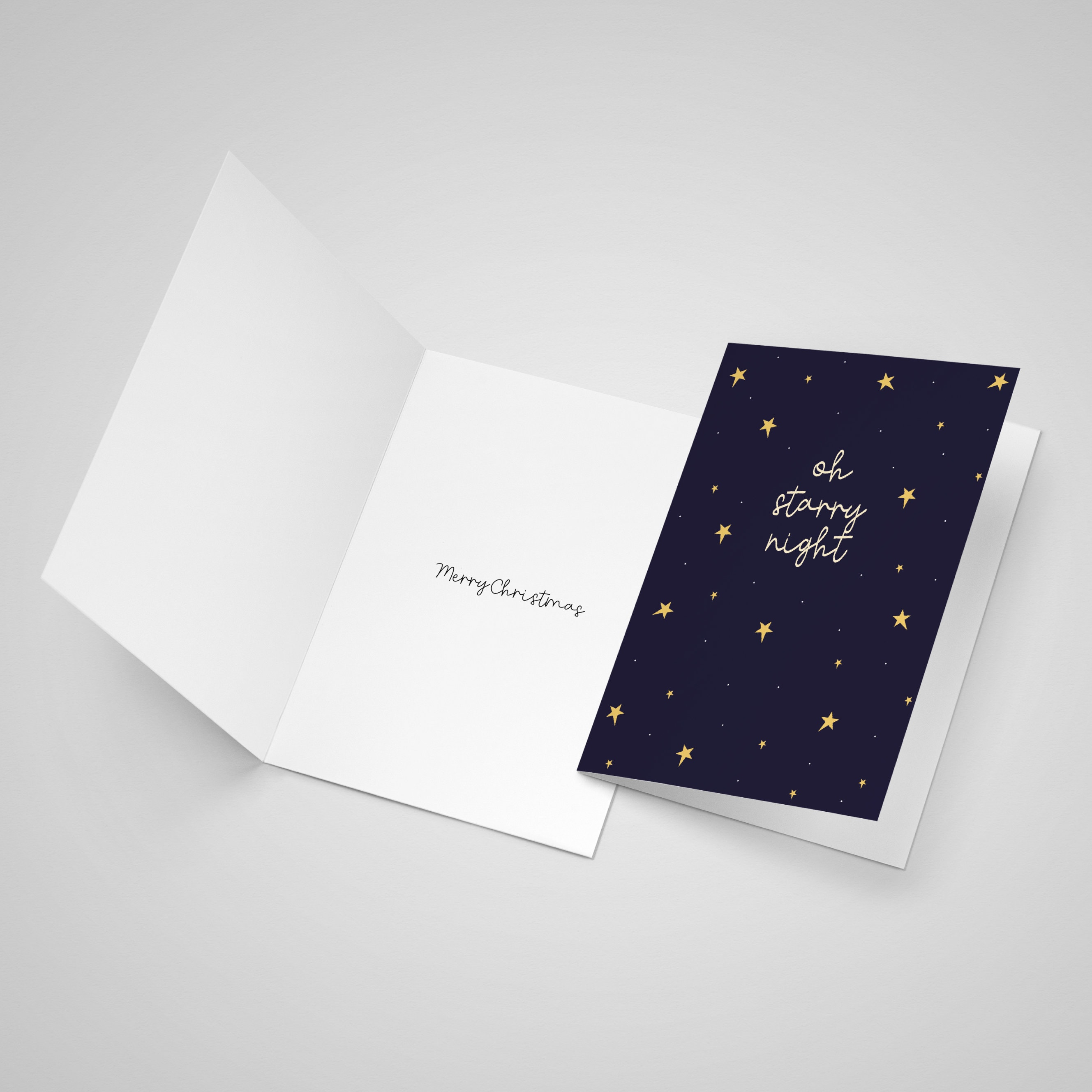 """Open card showing that the inside of the card has a """"Merry Christmas"""" message printed inside"""