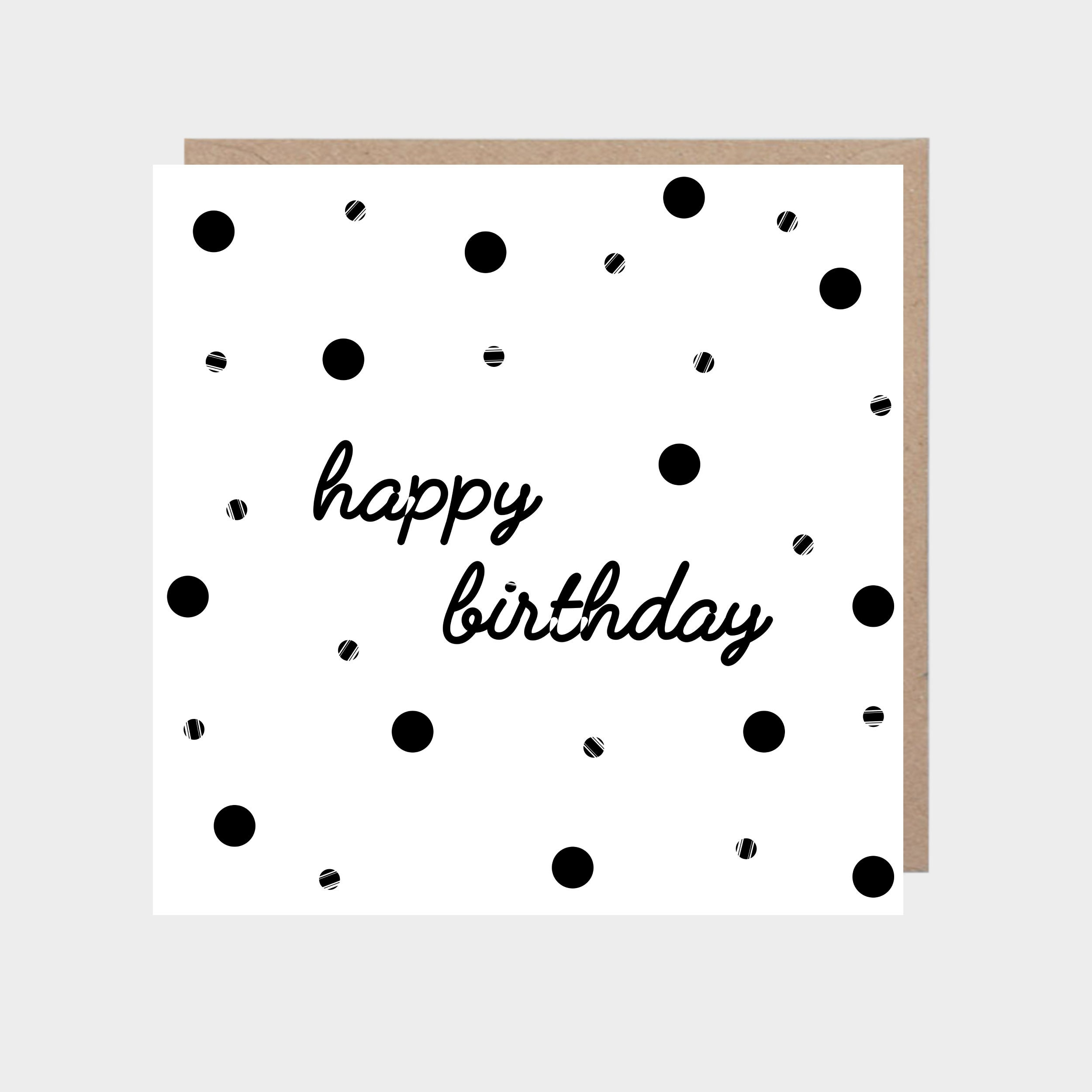 Square white card with black dots, with a brown kraft envelope