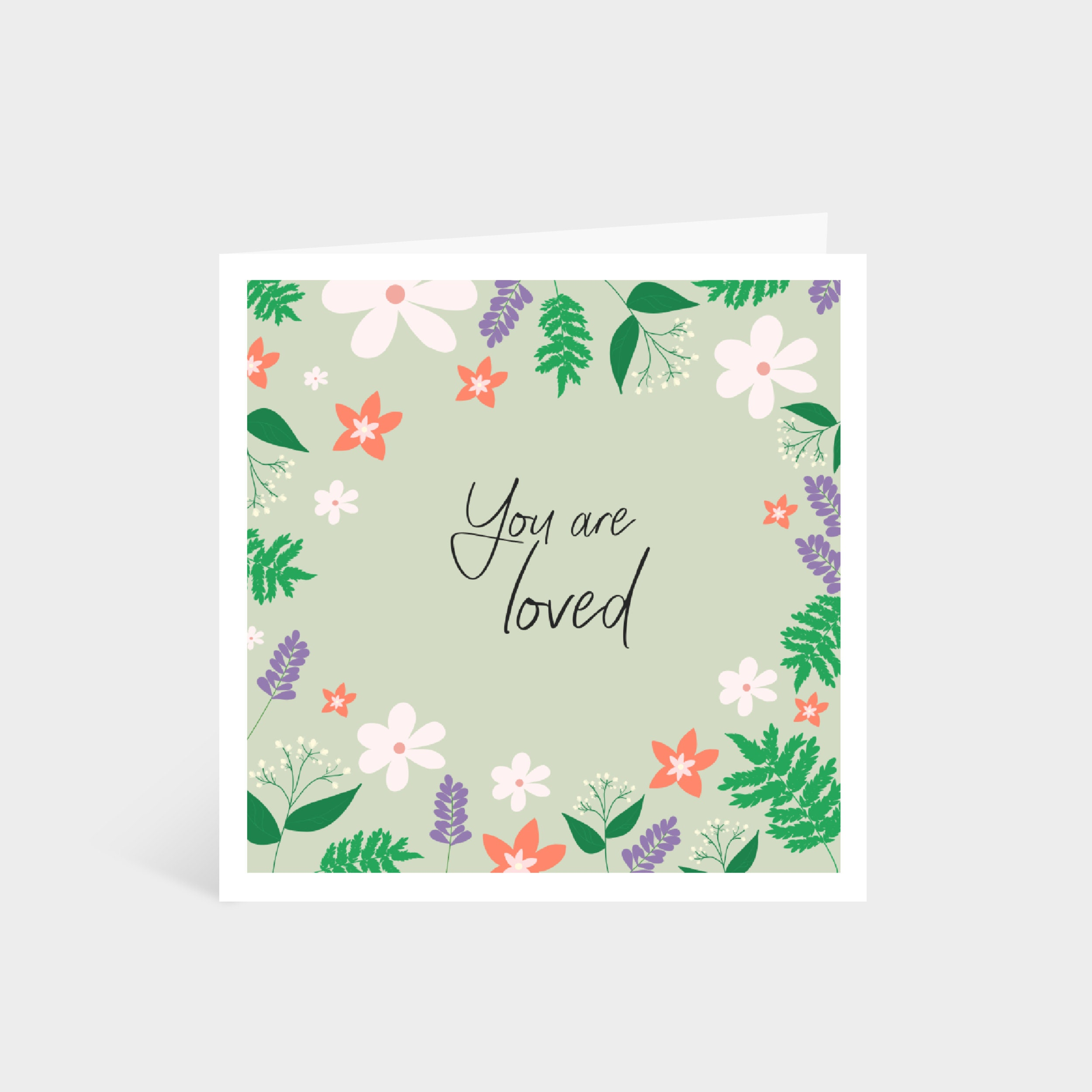 "Standing pale green square card with a colourful illustrated floral border; says ""You are loved"" in calligraphy font in the middle"