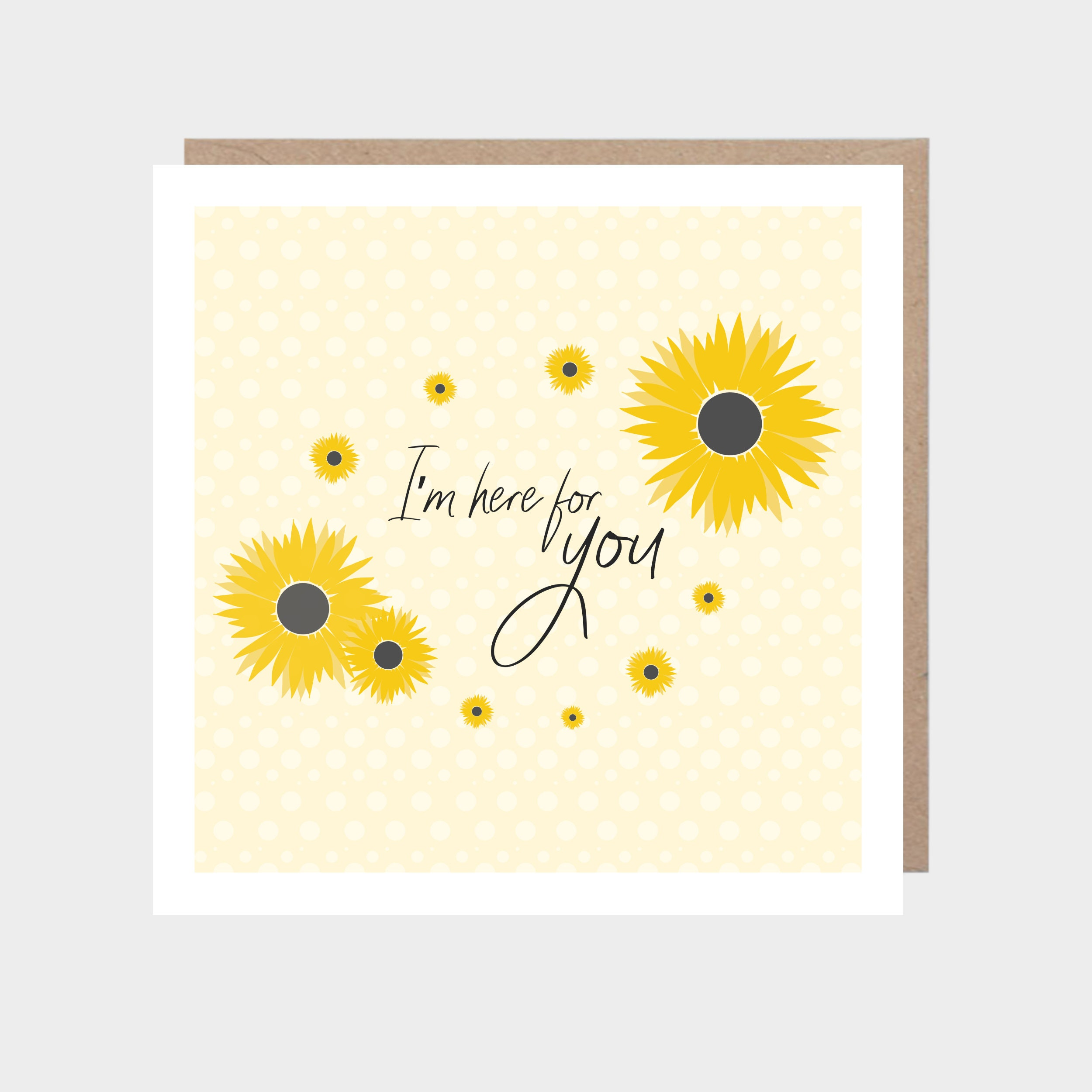 Pale yellow square card with a illustrated sunflowers, with a brown kraft envelope
