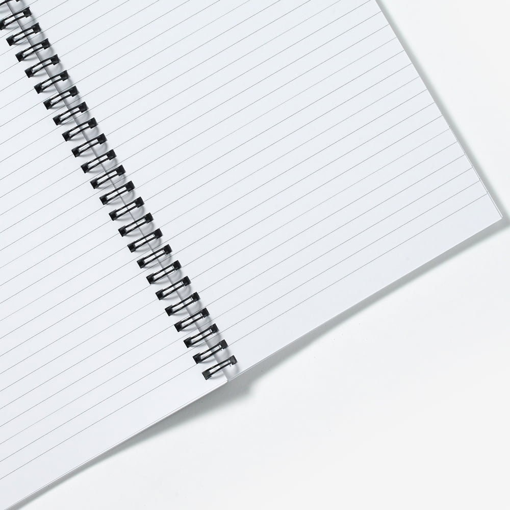 A close-up shot of the inside of a ruled/lined paper notebook