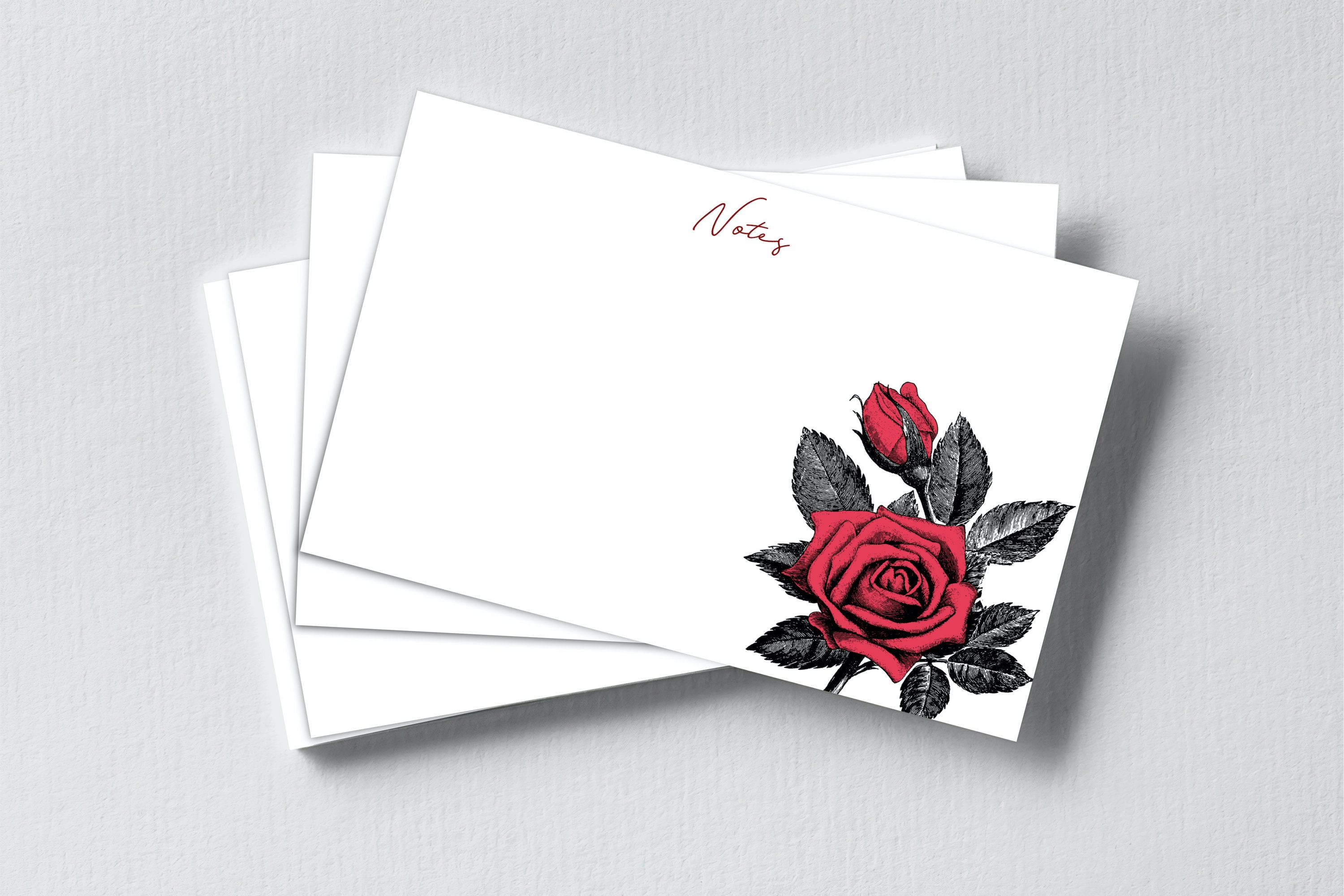 A stack of notecards with an illustration of a red rose on each.