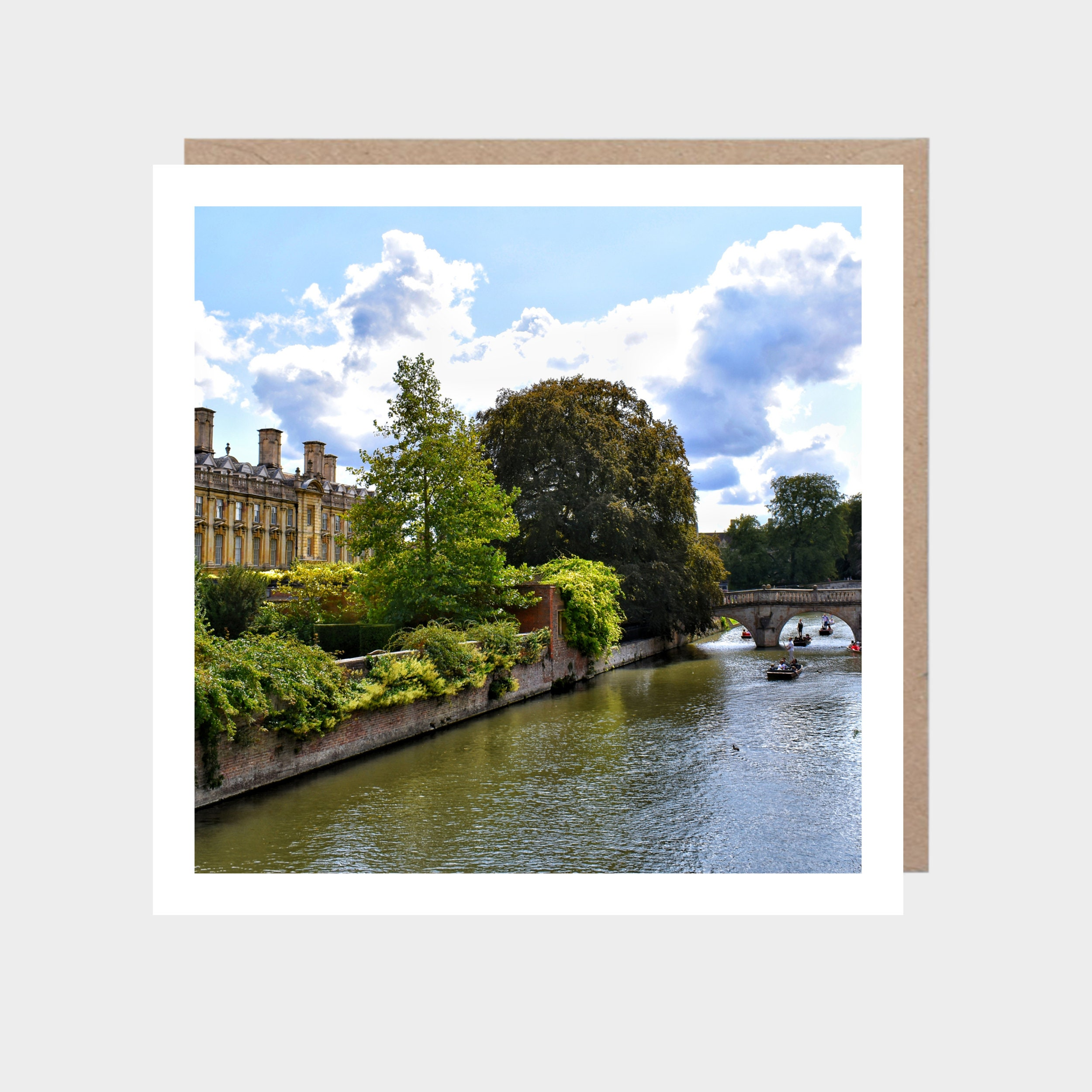 Square card with a photo of The Backs in Cambridge with a brown kraft envelope