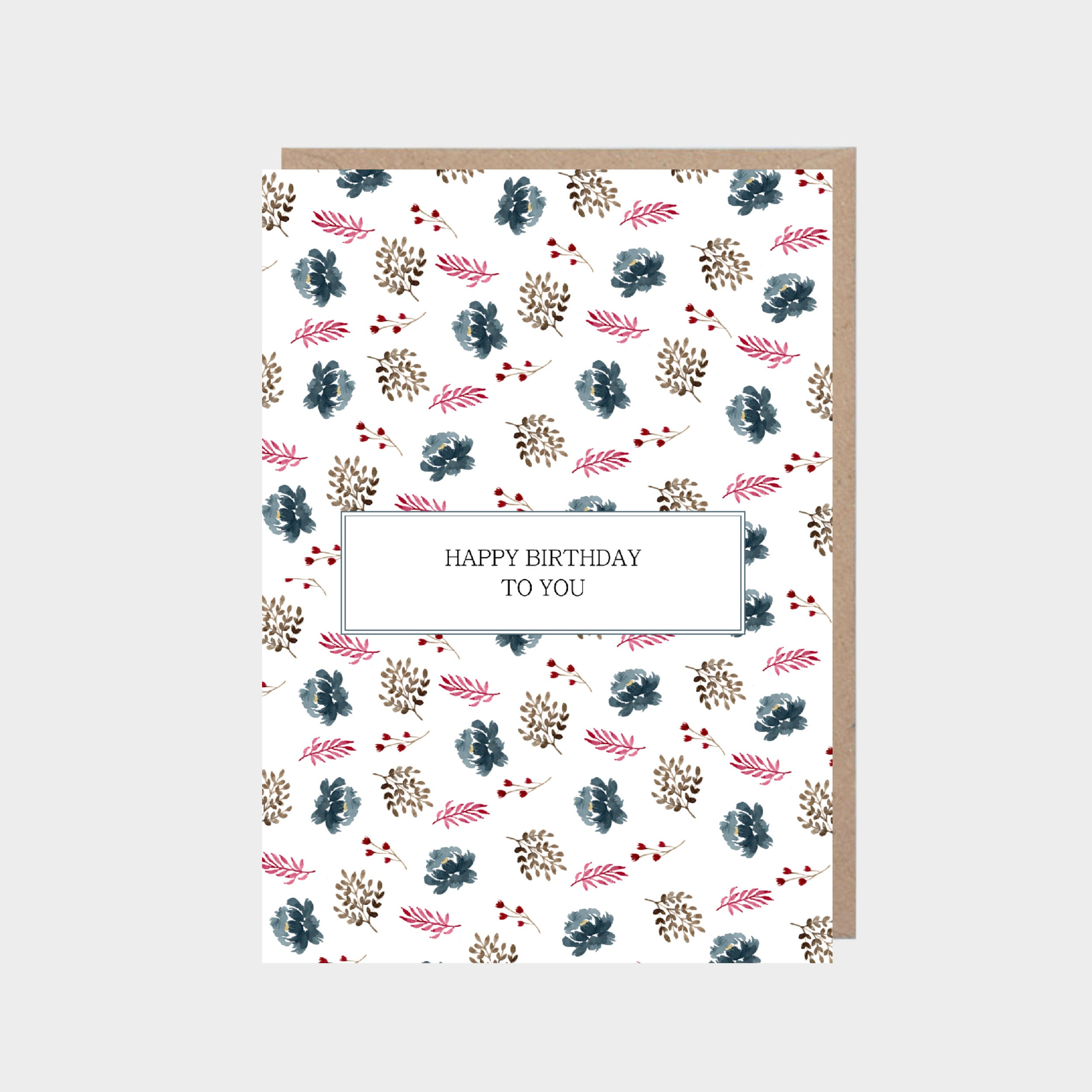 White card with an illustrated leafy and blue flowers pattern, with a brown kraft envelope.