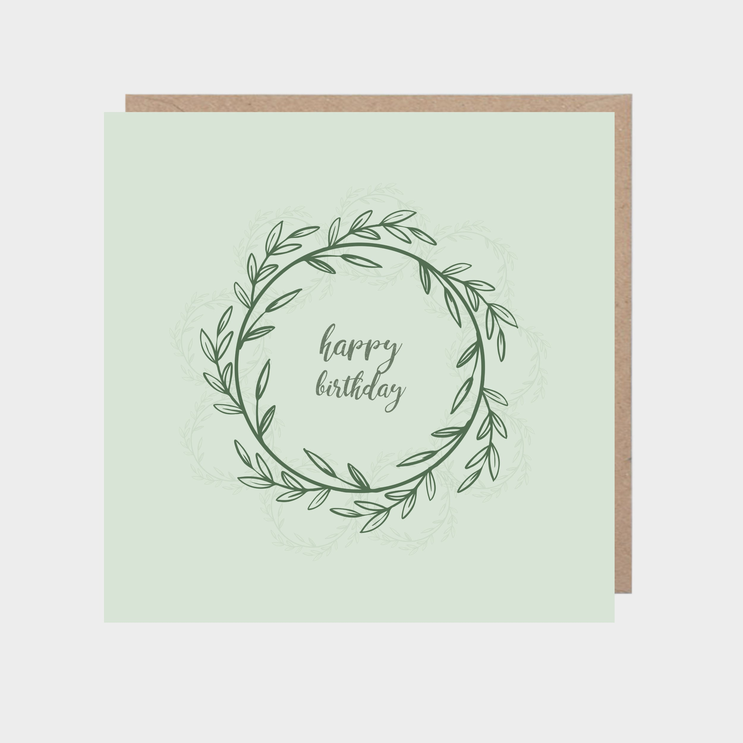 Square green card with floral wreath, with a brown kraft envelope