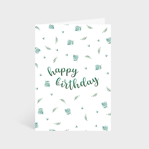 "Standing white card with a green leafy pattern. Text in the centre of the card says ""Happy Birthday"""