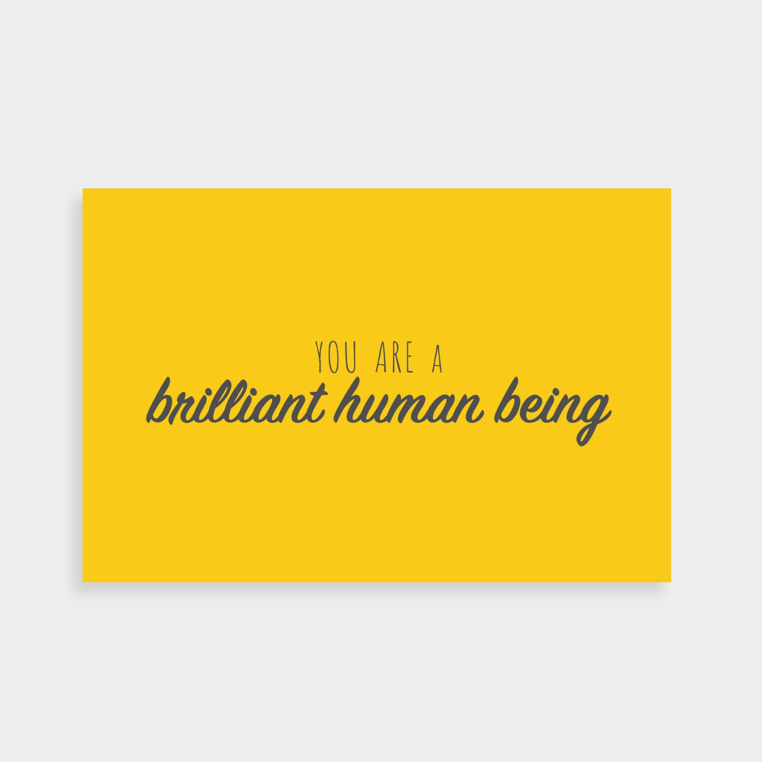 "Bright yellow postcard which says ""You are a brilliant human being"" in a dark grey calligraphy font in the middle"