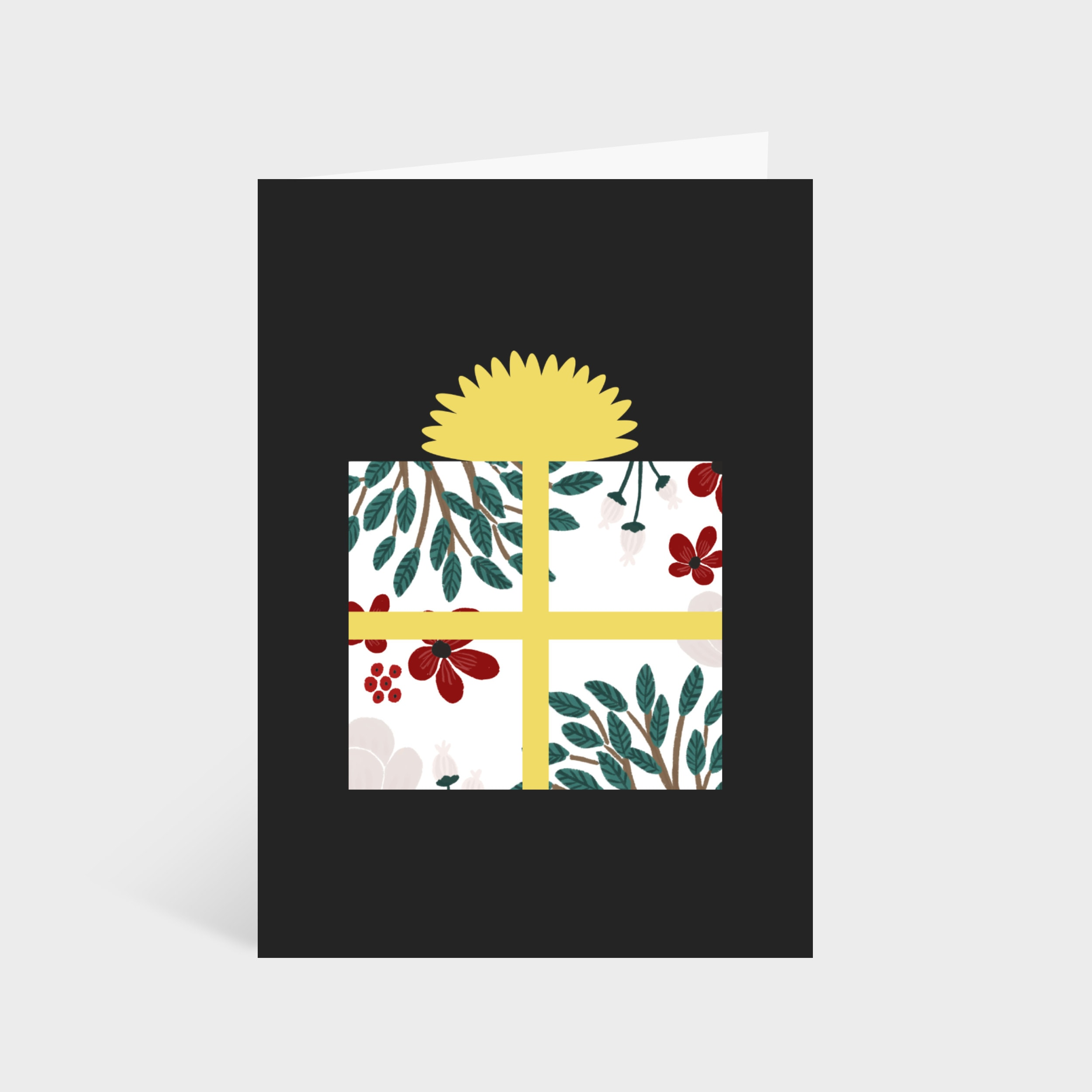 Standing black card with illustrated white and floral present in the centre.