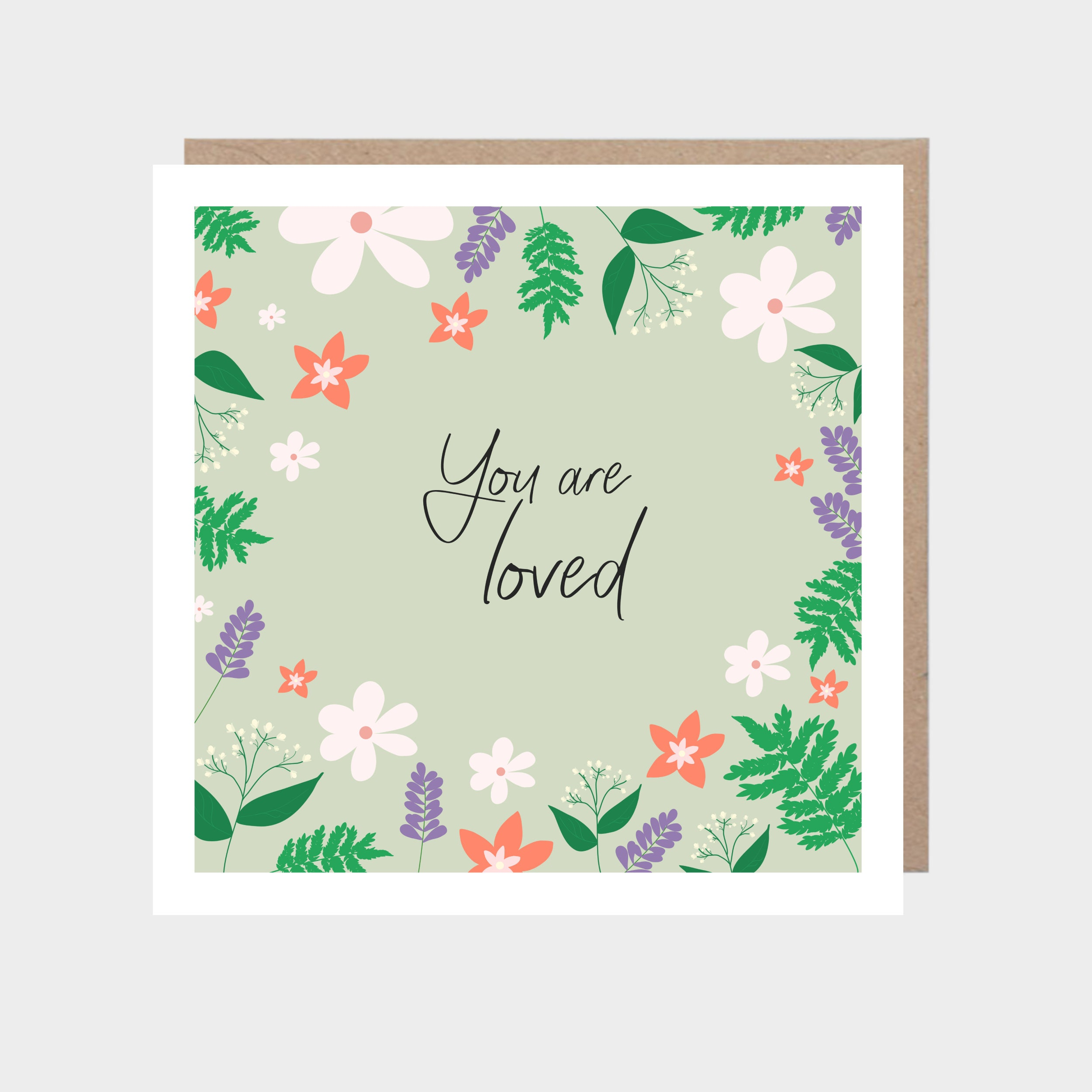 Pale green square card with an illustrated floral border, with a brown kraft envelope