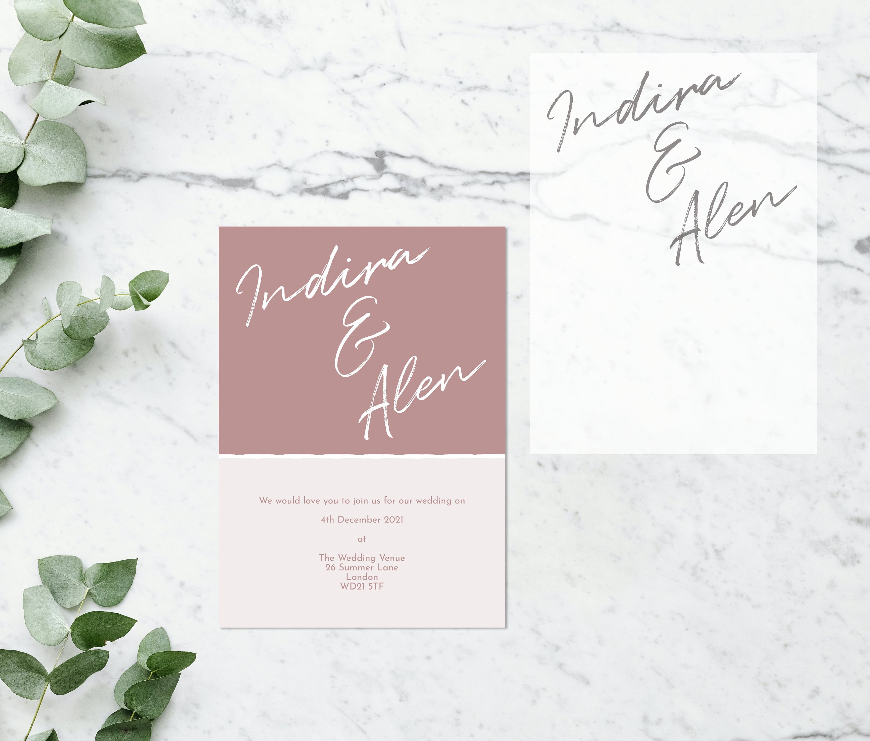 Flat lay photograph showing a blush pink wedding invitation and the vellum overlay sheet separately.