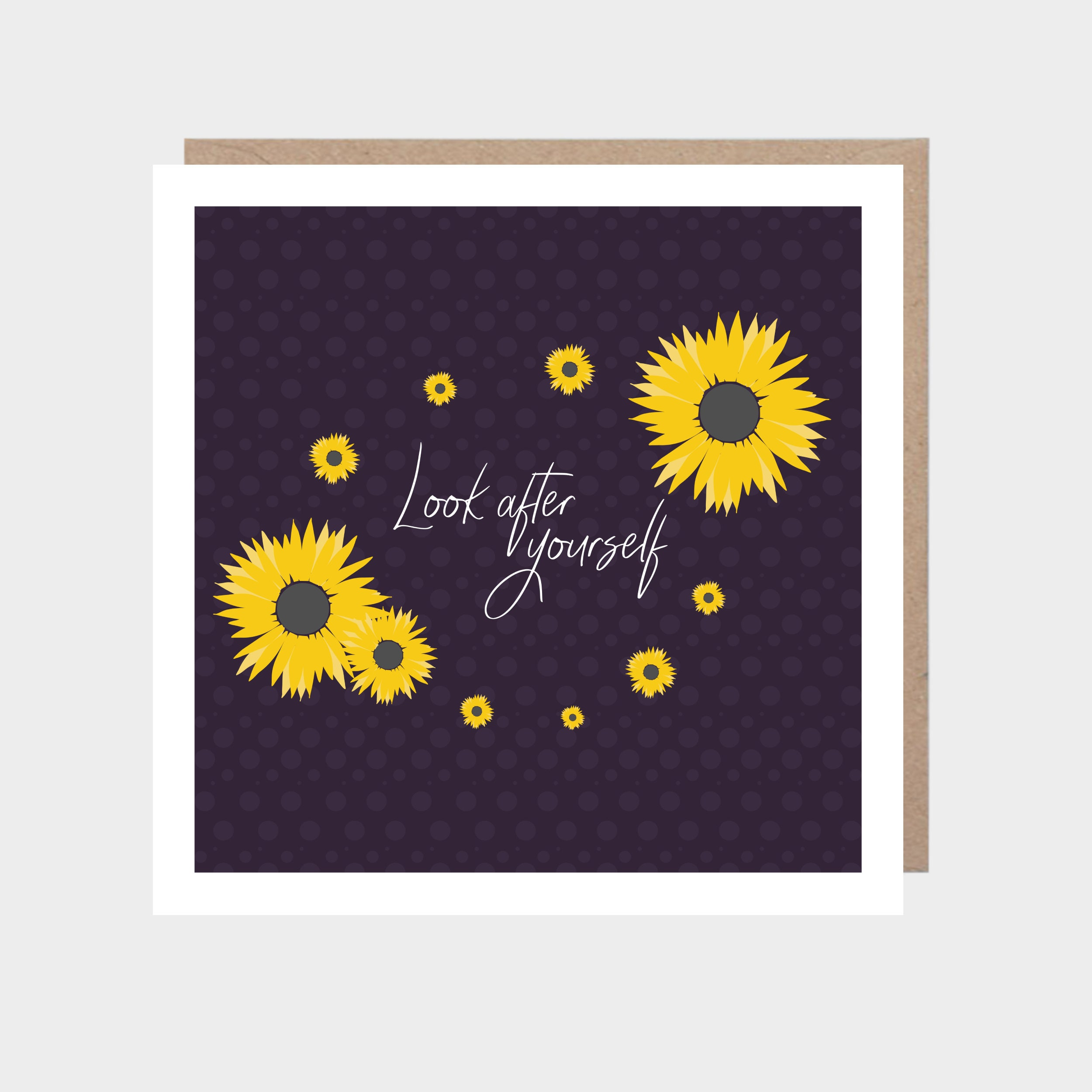 Dark purple square card with illustrated sunflowers, with a brown kraft envelope