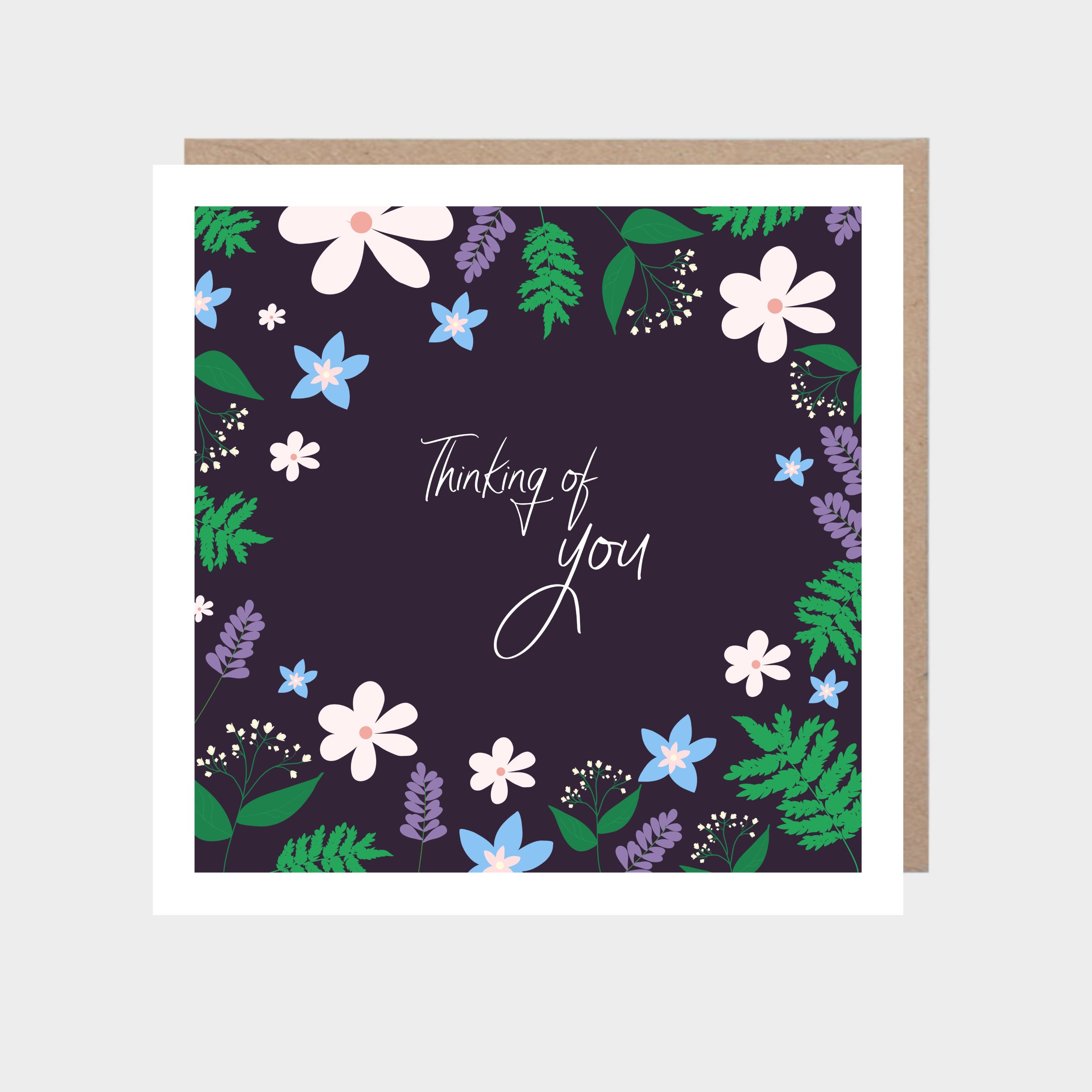 Dark purple square card with an illustrated floral border, with a brown kraft envelope