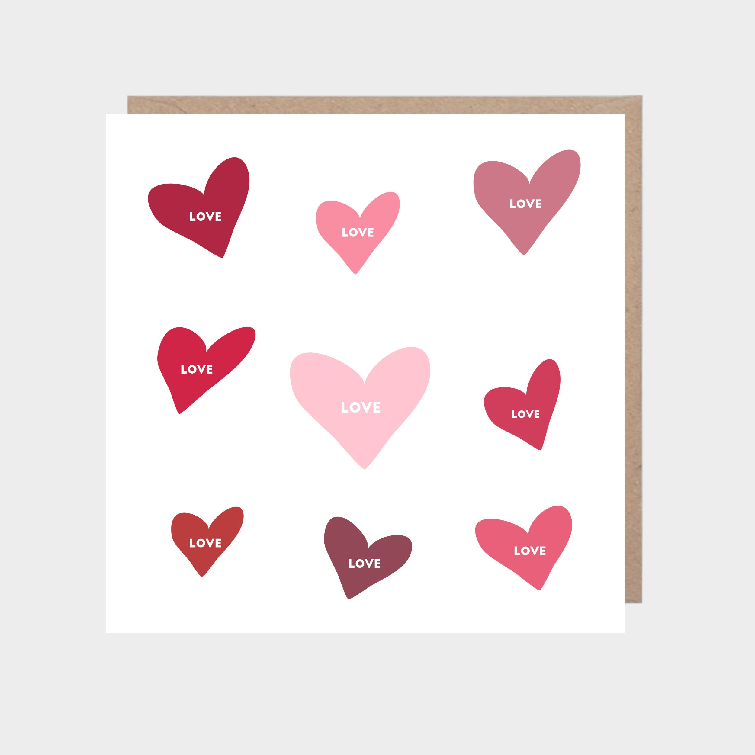 Square card with hand-drawn hearts, with a brown kraft envelope