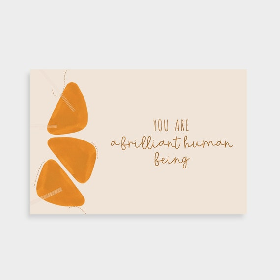 "Neutral cream postcard with abstract terracotta orange shapes and dotted line drawings on the left. Postcard text says ""You are a brilliant human being"" on the right"