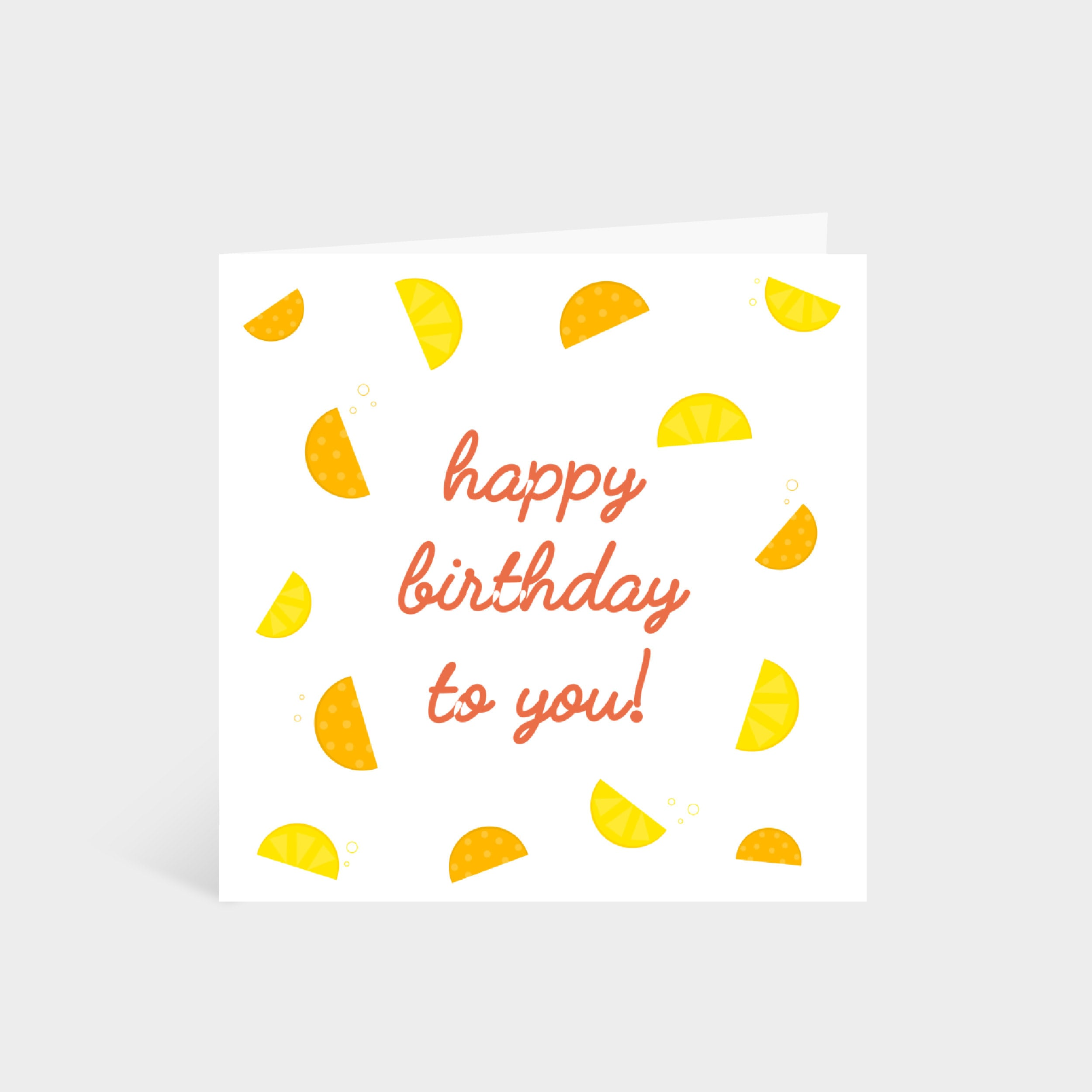 Standing square white card with illustrated lemon and orange slices, and the words 'Happy Birthday!' in the middle