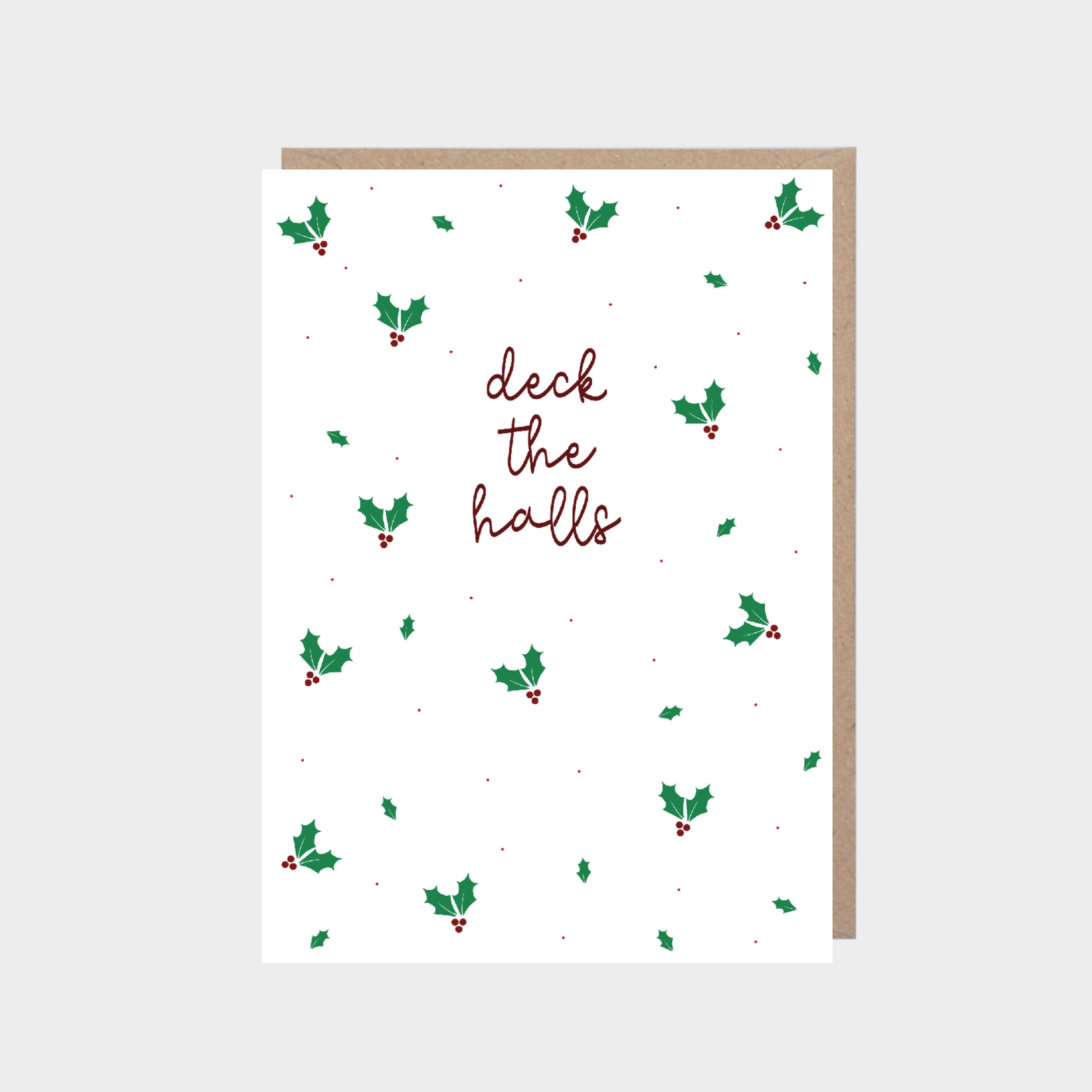 White card with holly leaves, with a brown kraft envelope.
