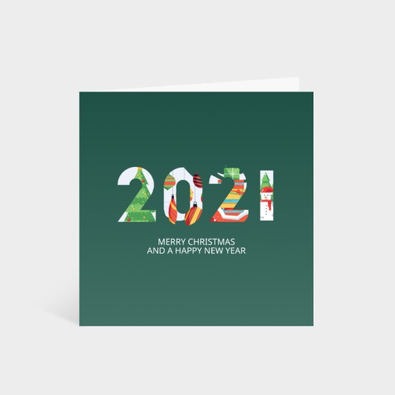 Standing square green card with large 2021 numbers, decorated with festive illustrations, and the words 'Merry Christmas and a Happy New year' underneath