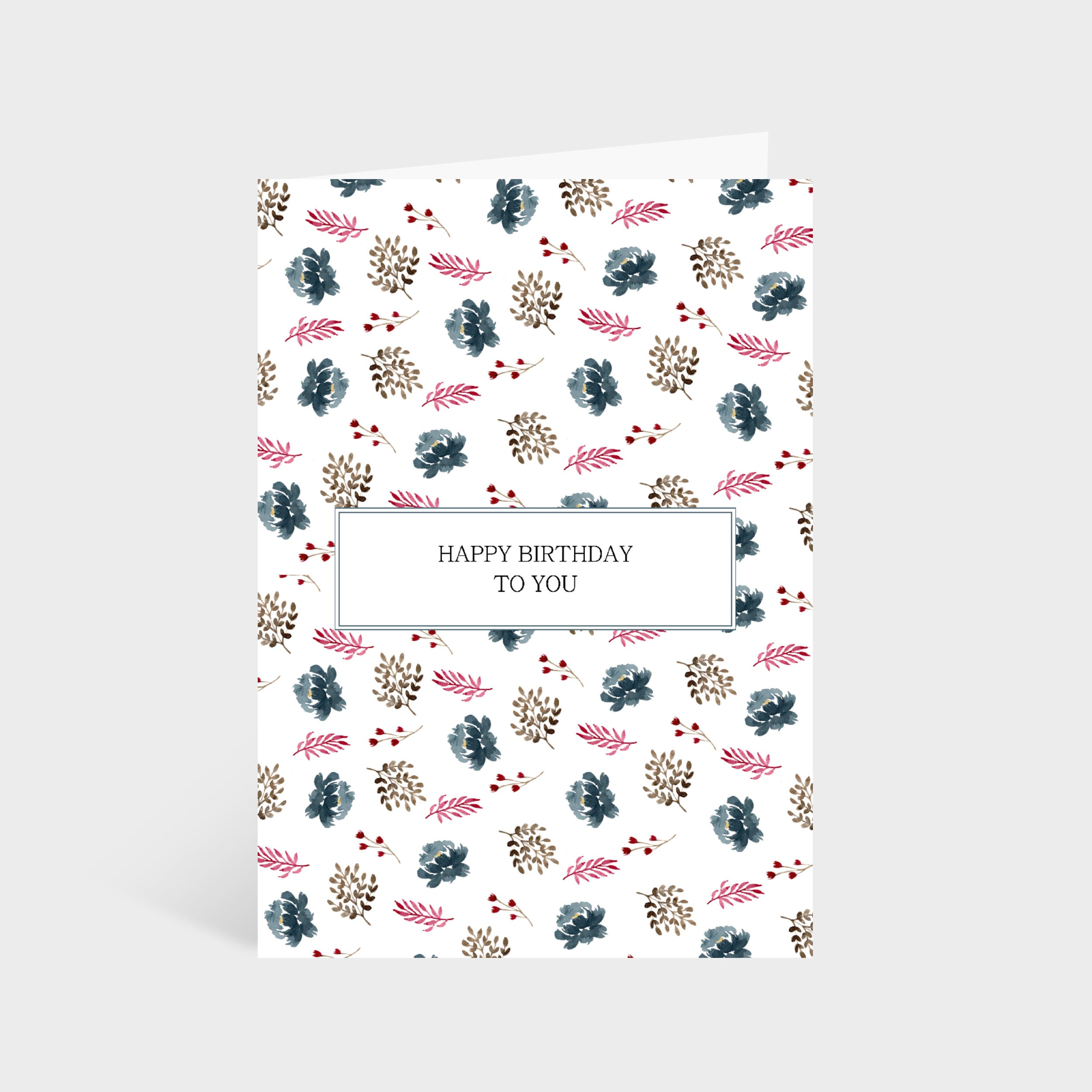 """Standing white card with an illustrated leafy and blue flowers pattern. A box in the centre has the text """"Happy Birthday to you"""""""