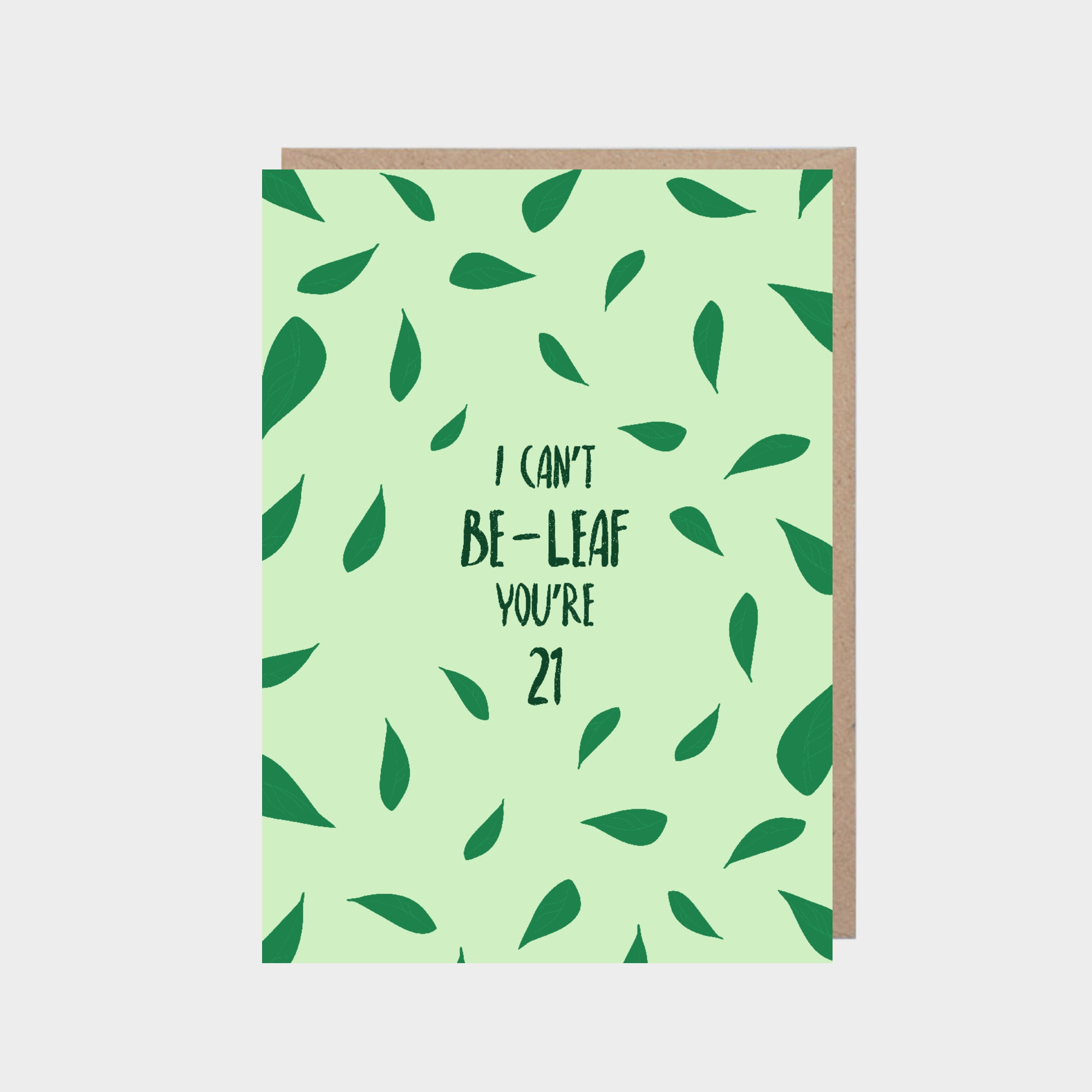 Standing light green card with illustrated leaves, with a brown kraft envelope