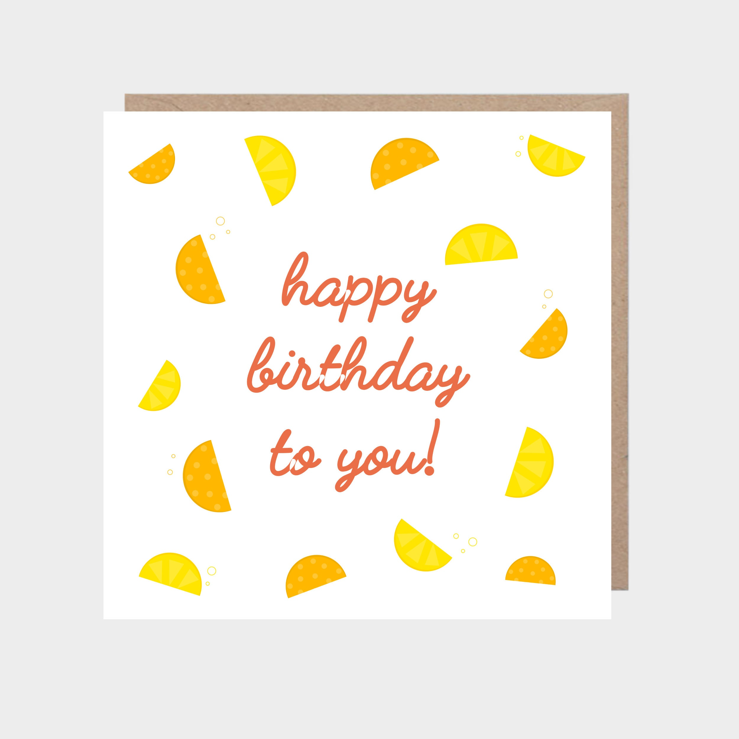 Square white card with illustrated lemon and orange slices, with a brown kraft envelope