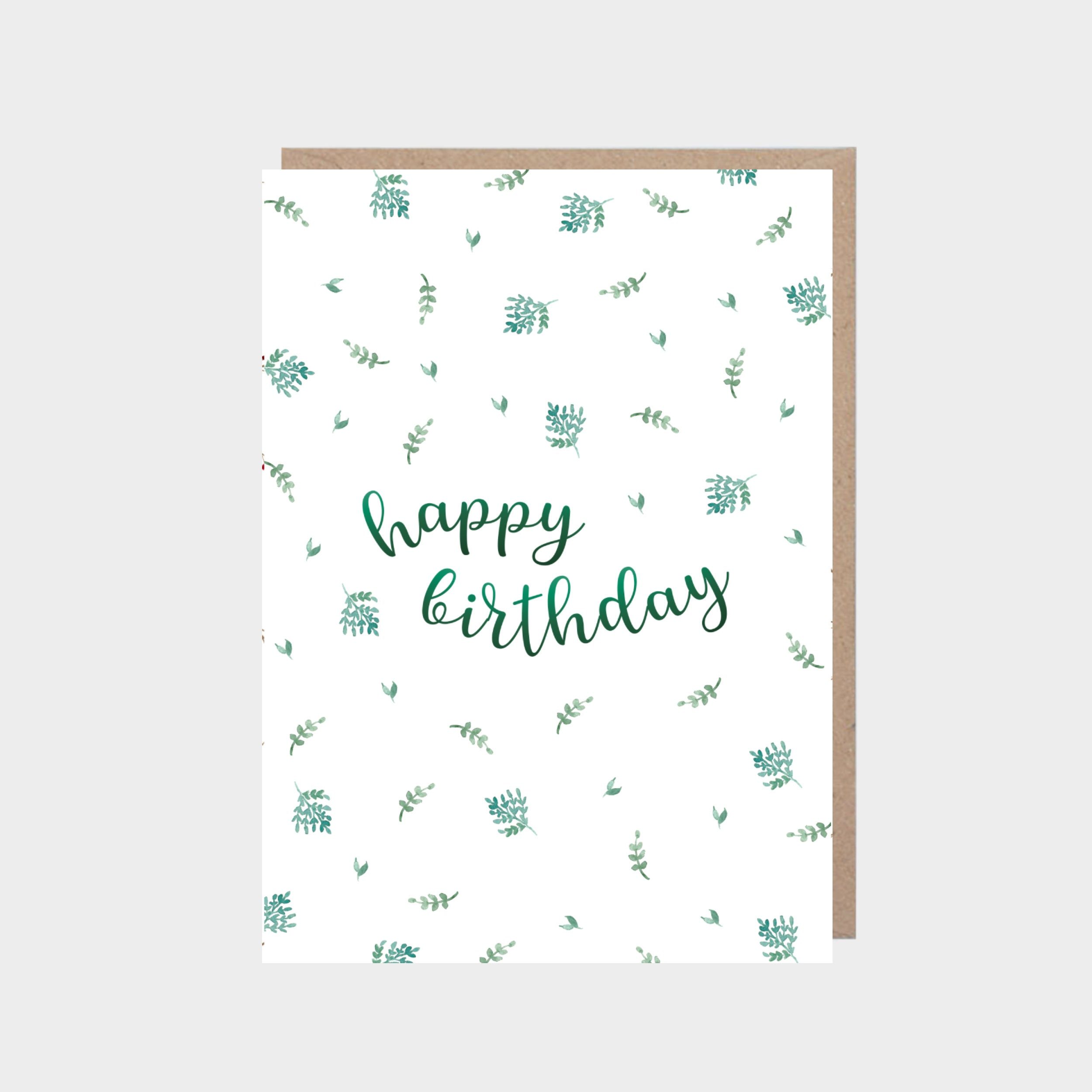 White card with a green leafy pattern, with a brown kraft envelope.