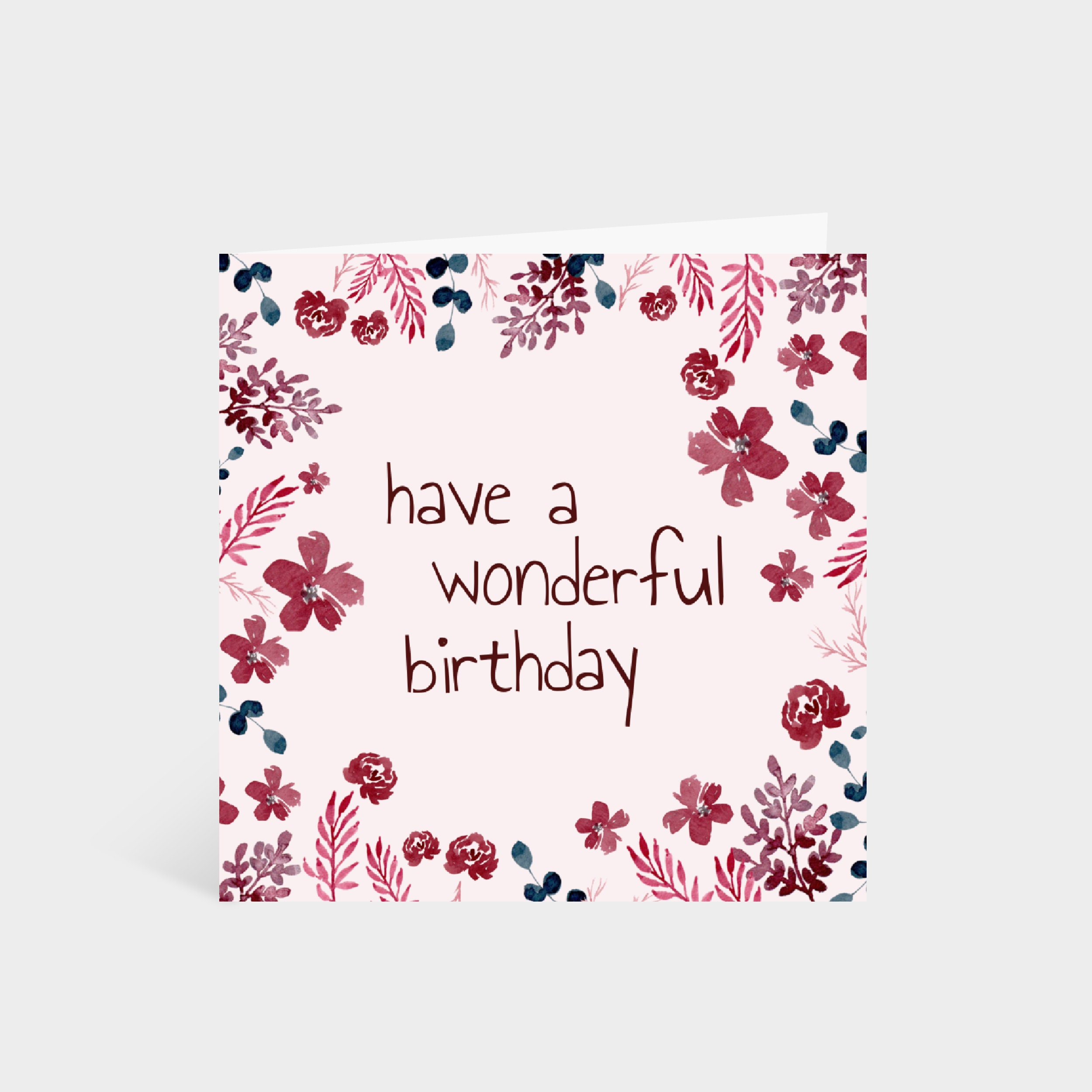 "Standing square pink card with illustrated navy and burgundy flowers around the edge. Text in the centre of the card says ""Have a wonderful birthday"""