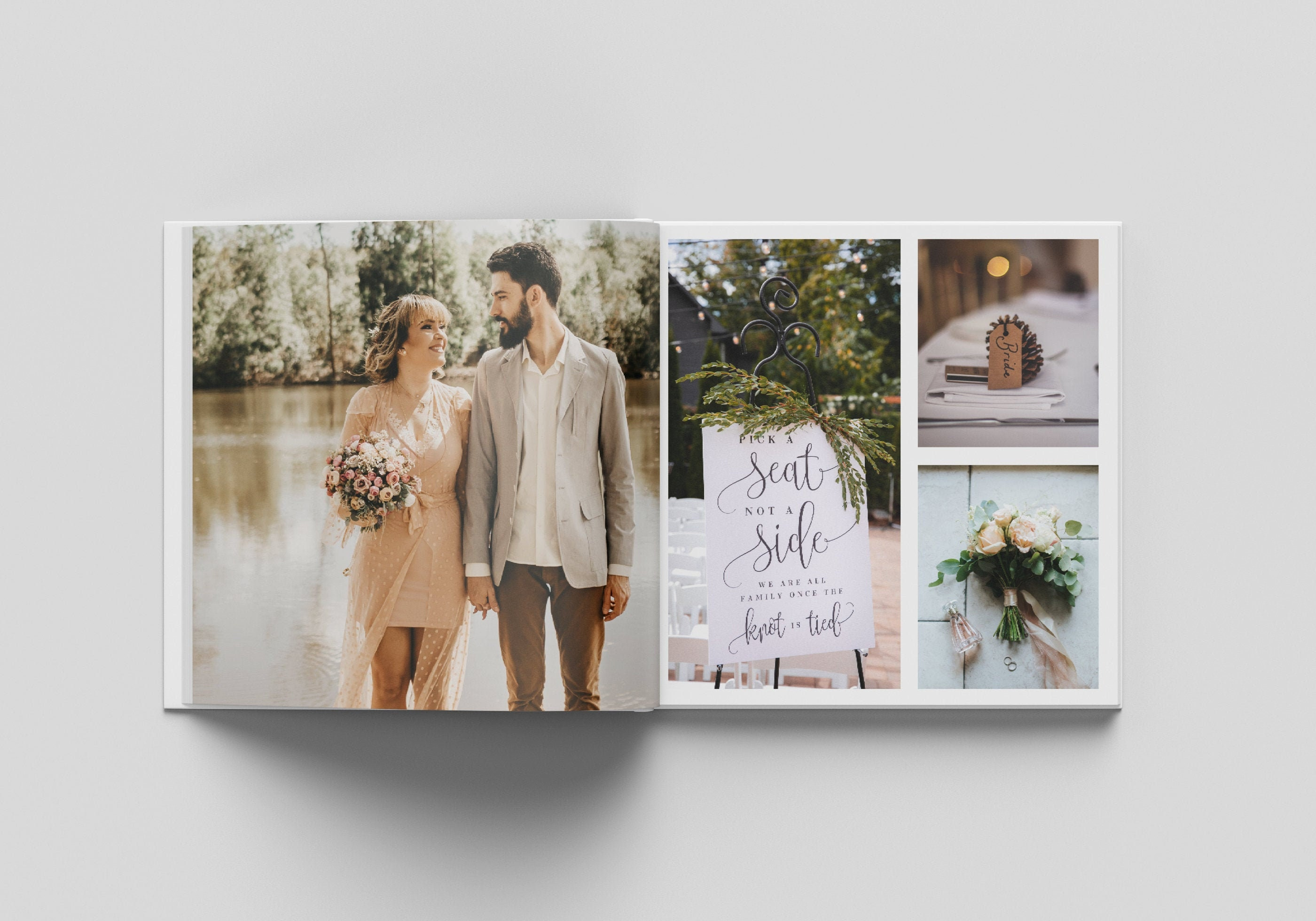 A photograph of an open book, with wedding photos printed on the pages inside. The left-hand page has an image printed to the page edges.