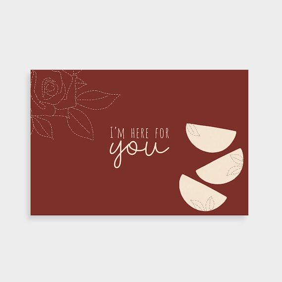 """Burgundy postcard with a stack of cream semi-circle shapes and a dotted rose drawing. Postcard says """"Here for you"""" in the middle."""