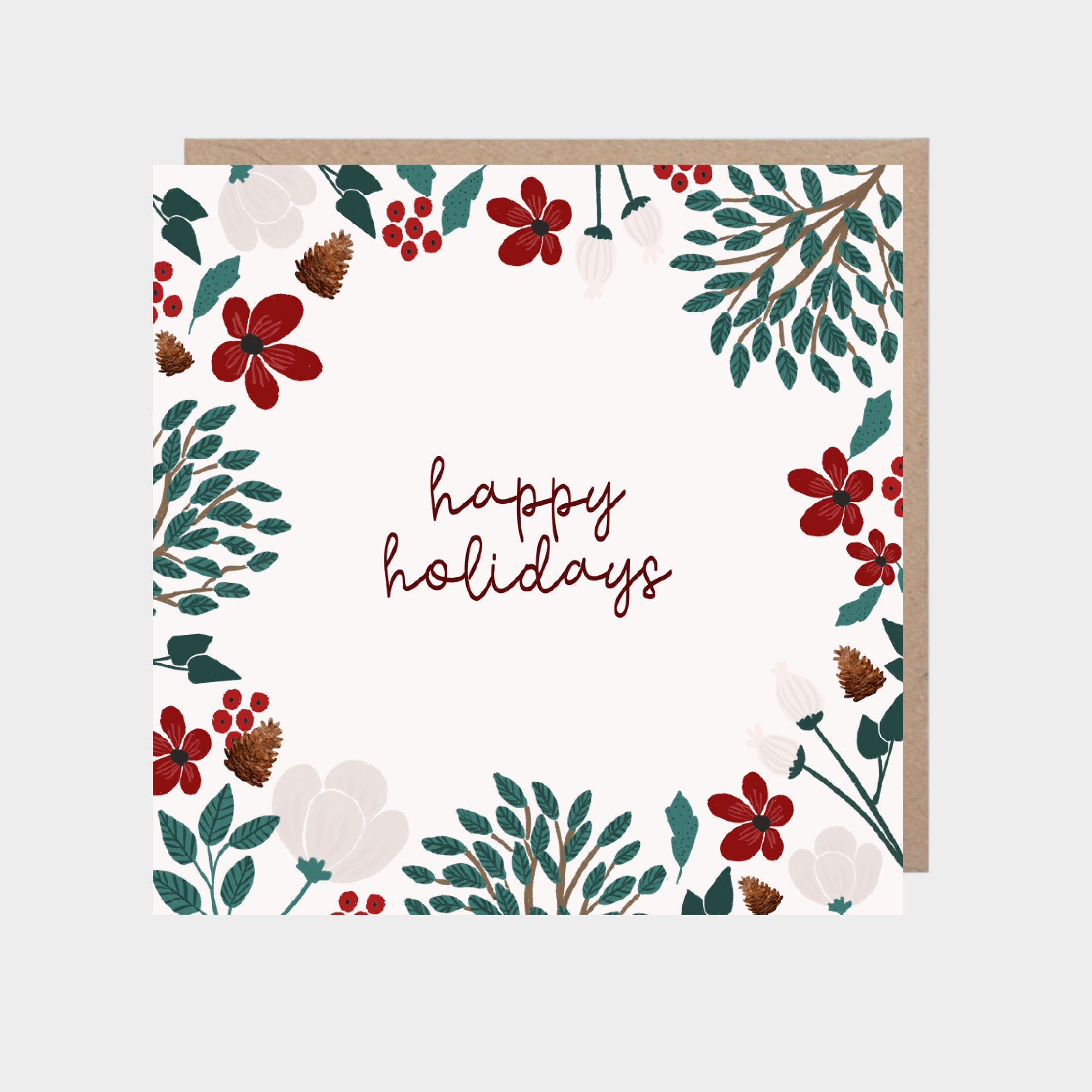 Square white card with a border of winter foliage and flowers, with a brown kraft envelope