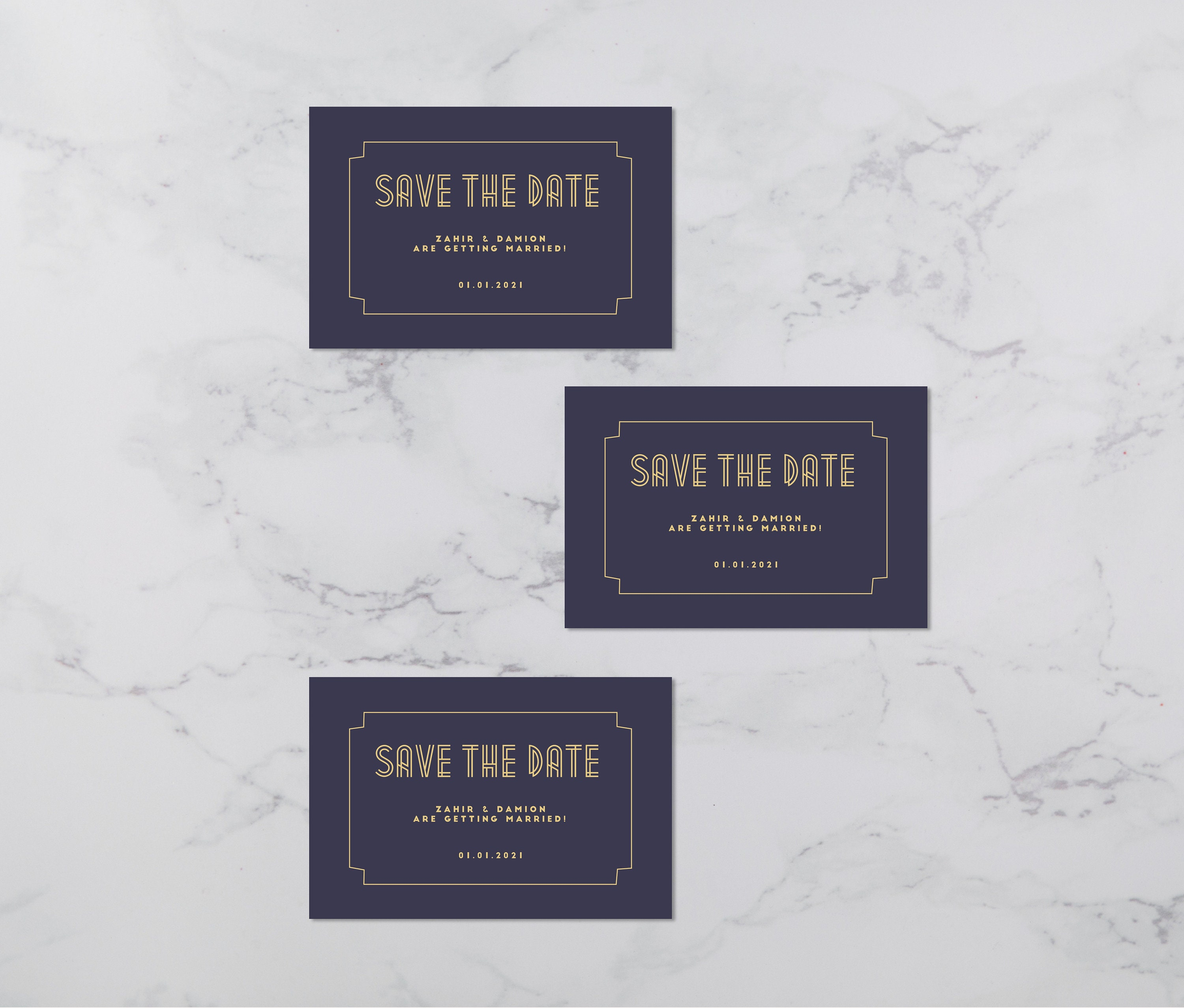 Flat lay photograph of 3 wedding save the date cards and white envelope. The design is art deco style, each card is navy card with gold colour details.
