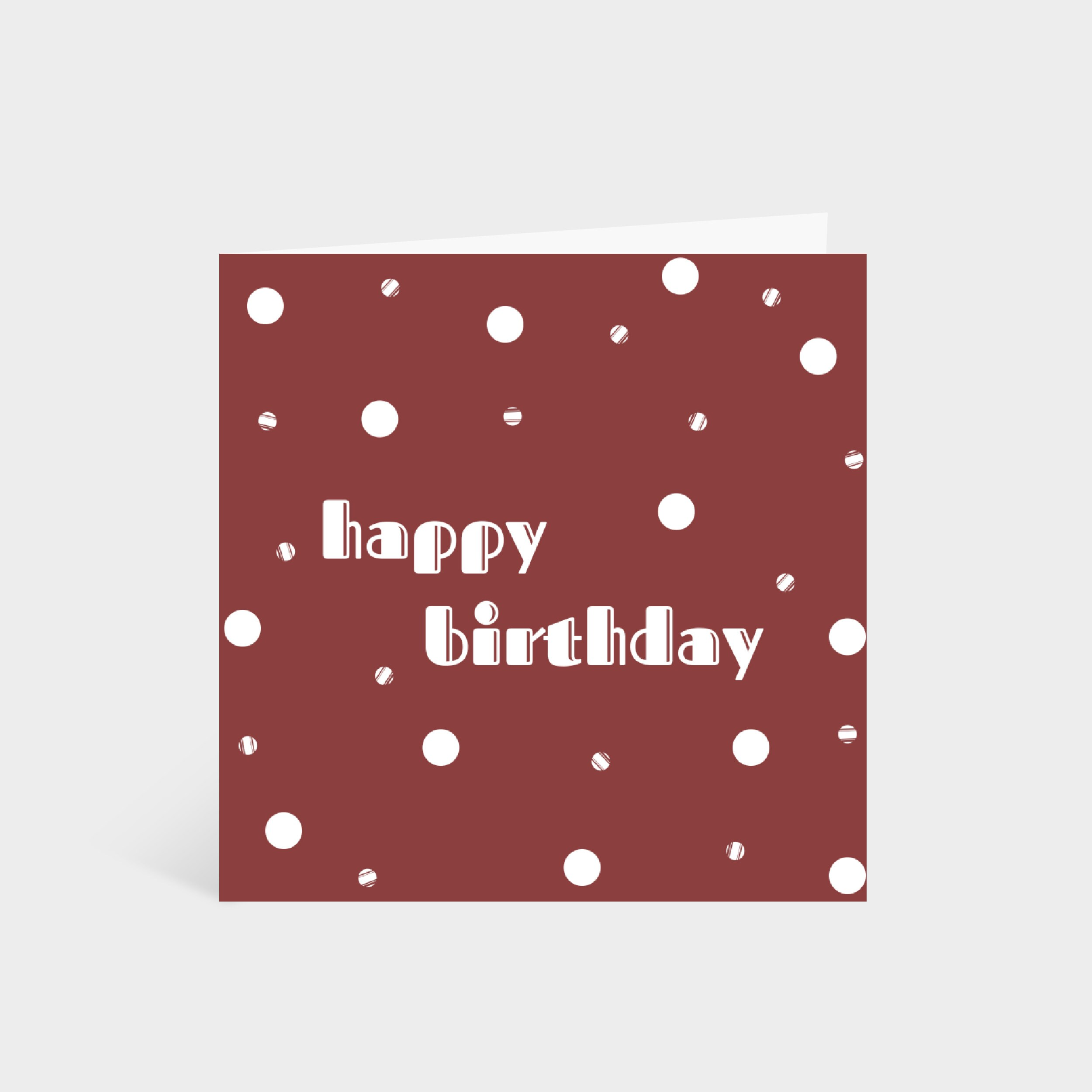 """Standing red card with a white polka dot pattern. Text in the middle says """"Happy Birthday""""."""