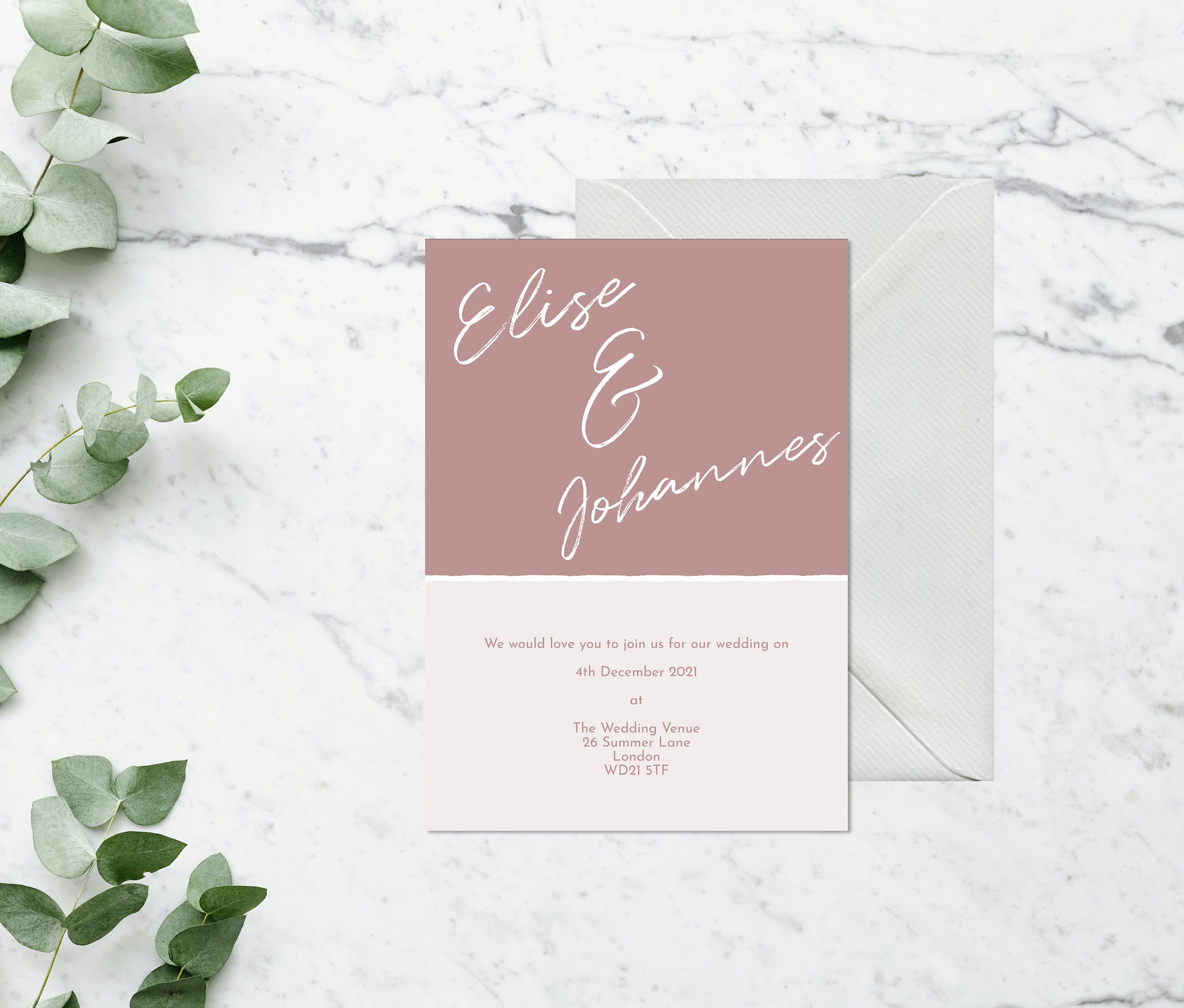 Flat lay photograph of a wedding invitation and white envelope. Each card is black and white, with headline text sitting between the two - both white and black.