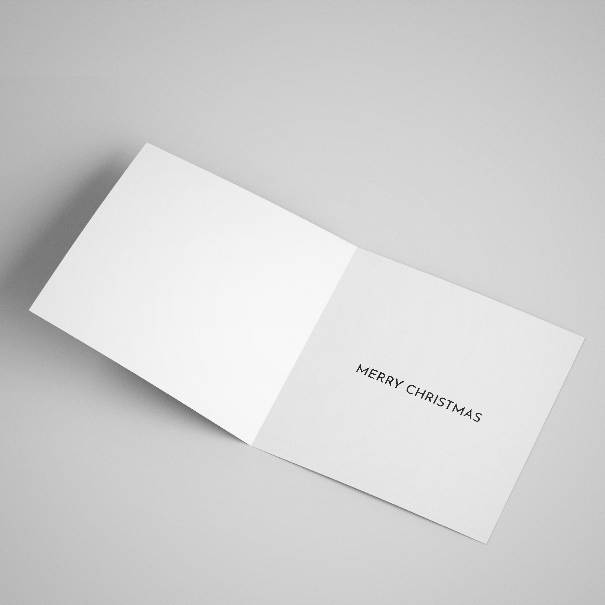 Open card showing that the inside of the card has a 'Merry Christmas' message